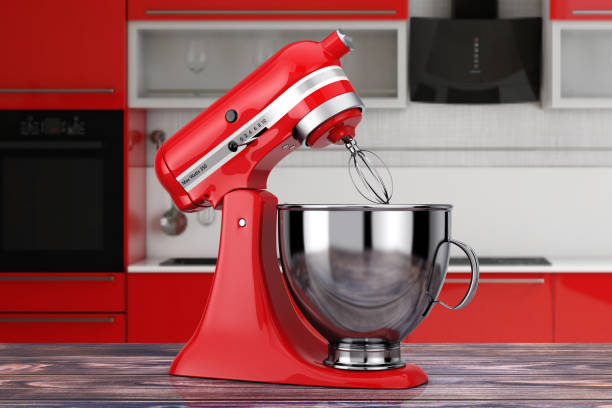 Red Kitchen Stand Food Mixer. 3d Rendering Red Kitchen Stand Food Mixer on a wooden table. 3d Rendering electric mixer stock pictures, royalty-free photos & images