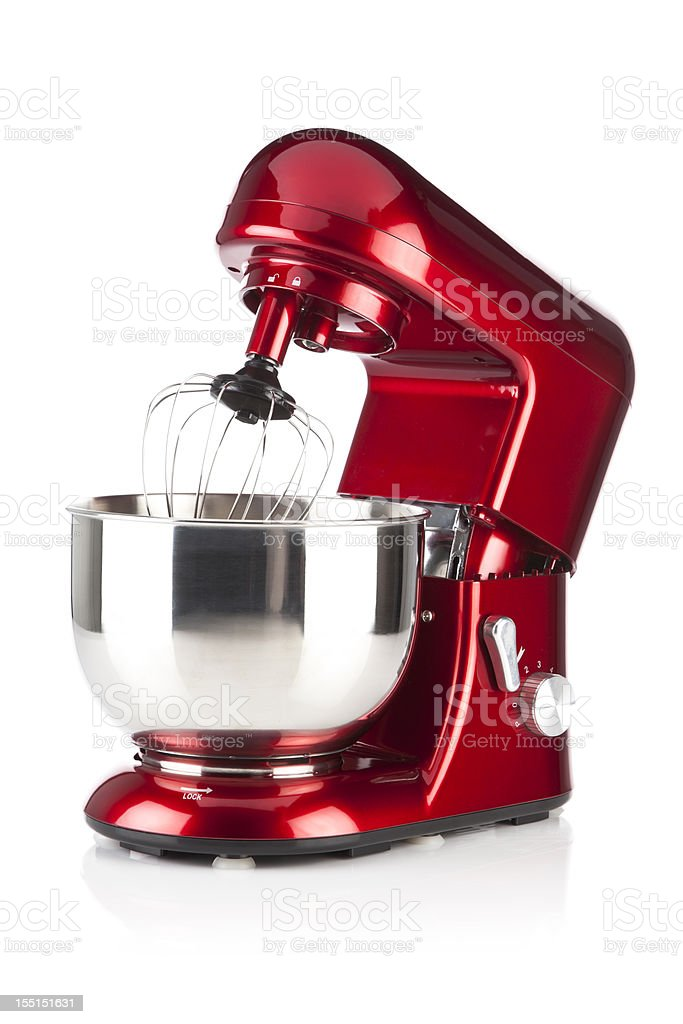 Red kitchen stand mixer shot on white backdrop stock photo