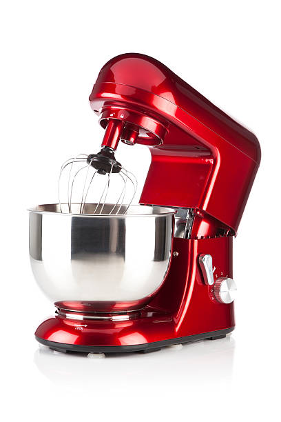 Red kitchen stand mixer shot on white backdrop Red Electric Mixer on White Background. Side View.  MORE RED HOUSEHOLD APPLIANCES ON MY PORTFOLIO http://i1215.photobucket.com/albums/cc503/carlosgawronski/HouseholdAppliances.jpg electric mixer stock pictures, royalty-free photos & images