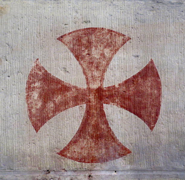 red knights templar cross painted on a wall in a church, close - knights templar stock pictures, royalty-free photos & images