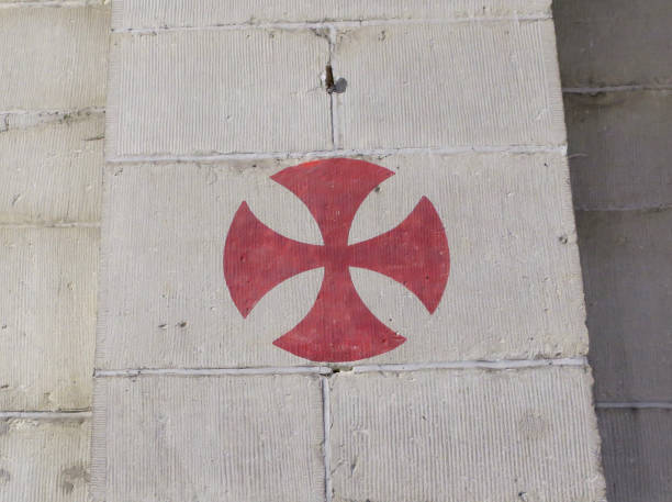 red knights templar cross painted on a wall in a church - knights templar stock pictures, royalty-free photos & images