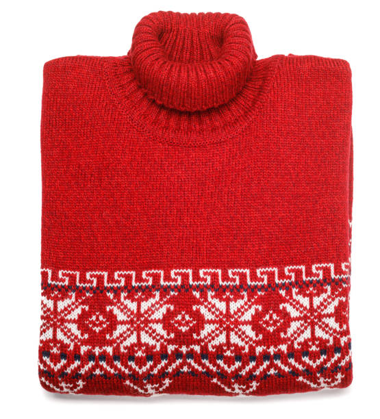 Red knitted Christmas turtleneck sweater with nordic ornament folded on white background stock photo