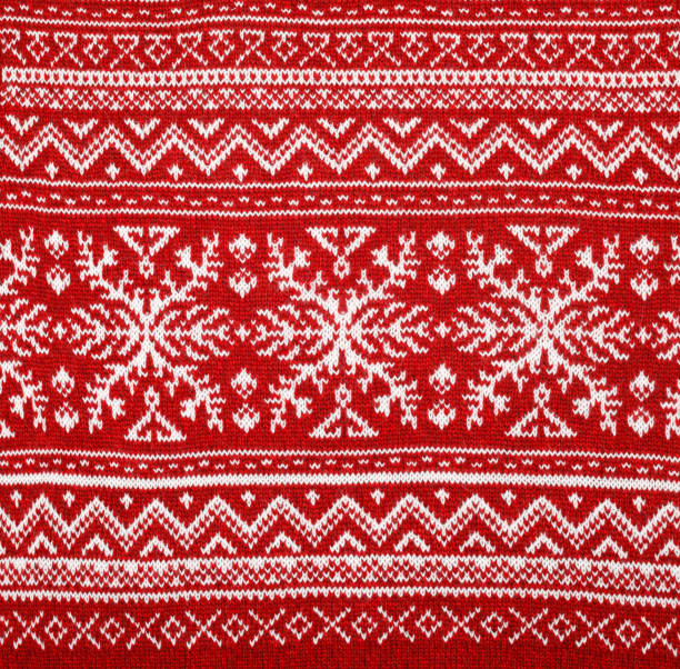 Red knitted fabric with nordic geometric ornament stock photo
