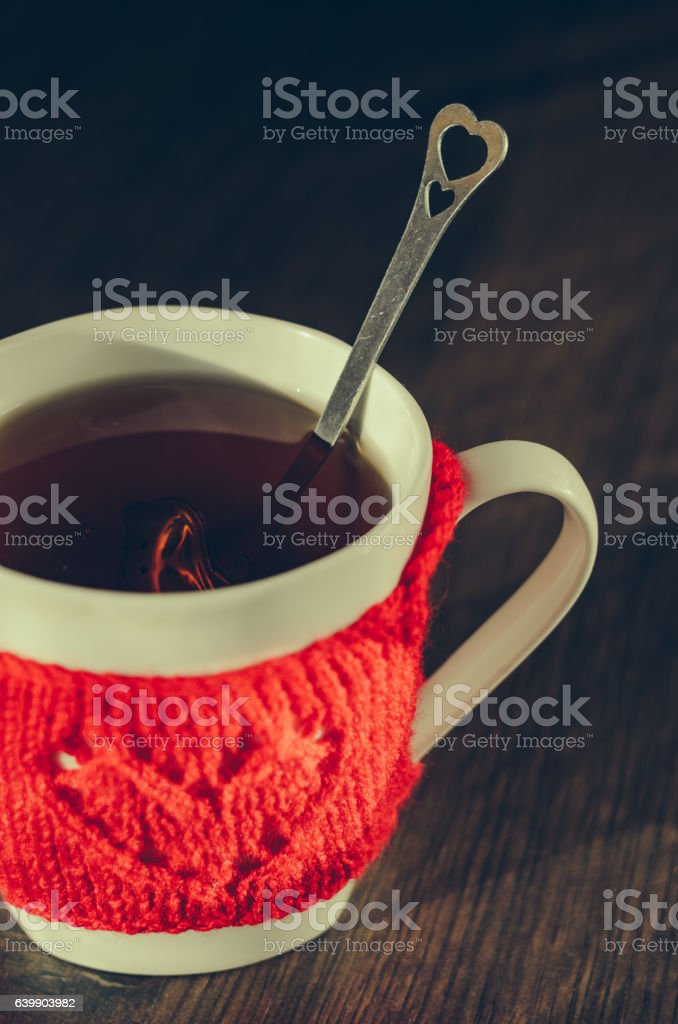 Red Knitted woolen cup with heart pattern stock photo