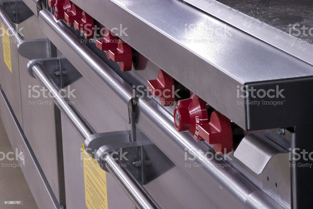 Red Knobs on Commercial Ovens stock photo