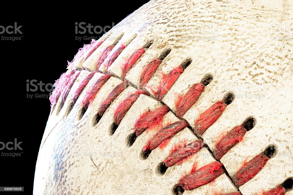 Red laces and white baseball with scares on it stock photo