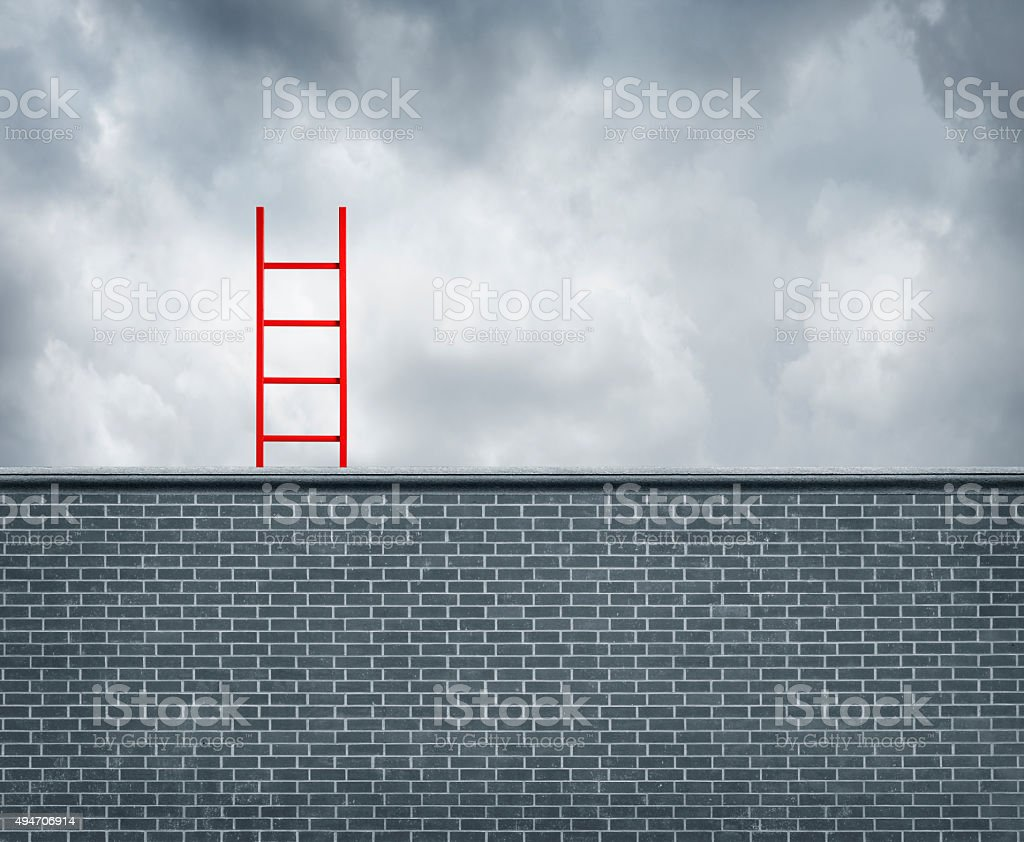 Red Ladder Leaning Up Against A Blank Wall stock photo