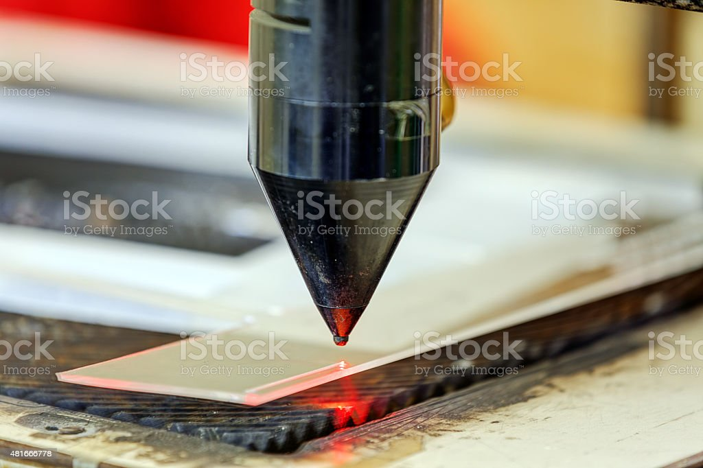 Red laser on cutting machine stock photo