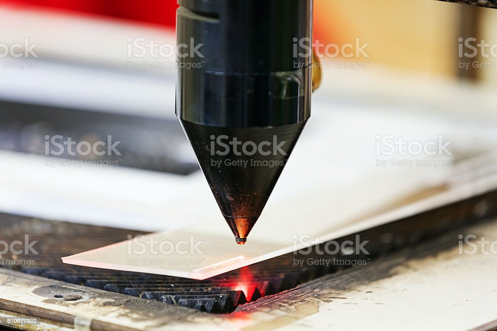 Red laser on cutting machine stock photo