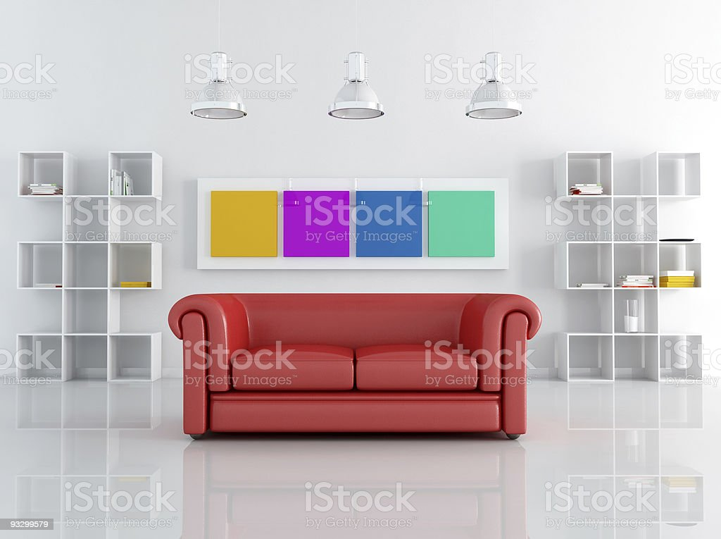 red leathe sofa in a white living room stock photo