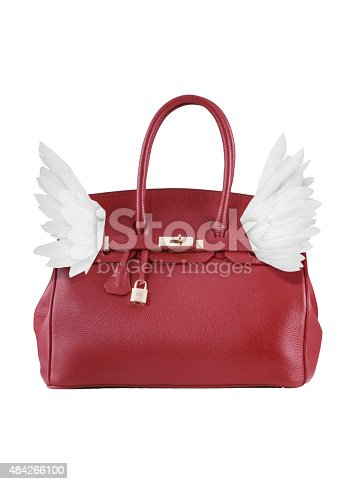 istock red leather bag flying 484266100