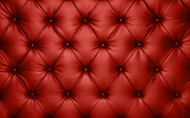 Red leather capitone background texture Close up background texture of scarlet red capitone genuine leather, retro Chesterfield style soft tufted furniture upholstery with deep diamond pattern and buttons tassel stock pictures, royalty-free photos & images