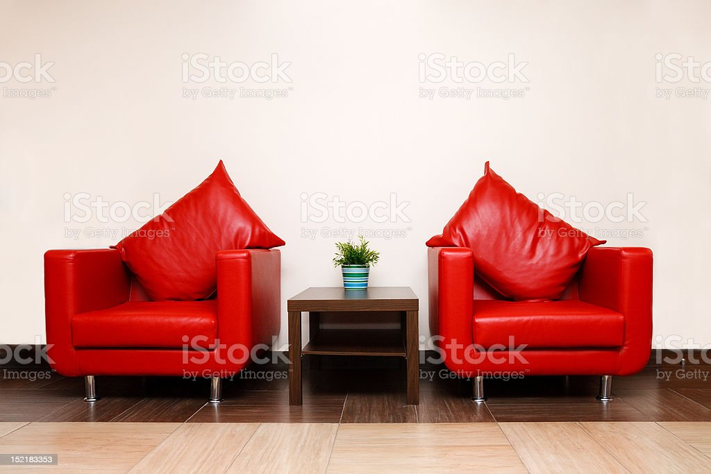 Red leather chairs with pillow royalty-free stock photo