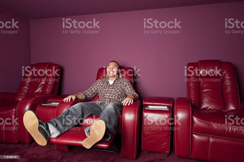 Red Leather Recliner Man Smiles stock photo