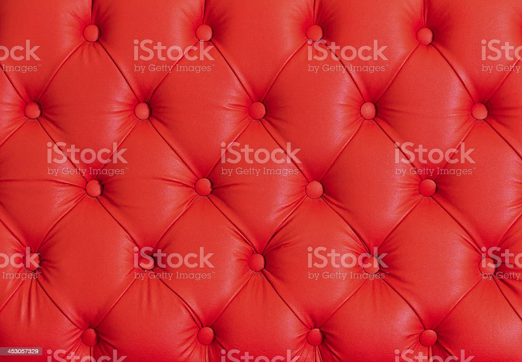 Red leather with buttons in diamond shape stock photo