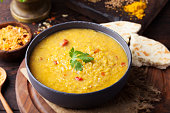 istock Red lentil Indian soup with flat bread. Masoor dal. 495455834