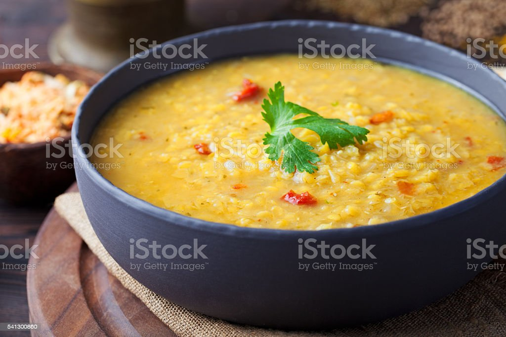 Red lentil Indian soup with flat bread Masoor dal stock photo