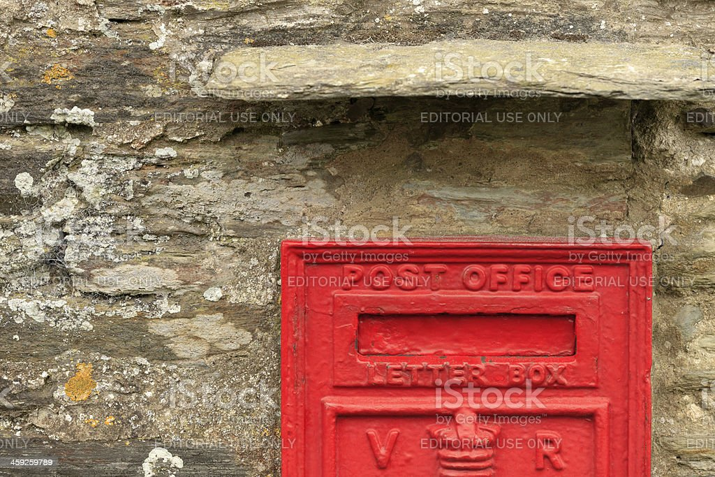 red letterbox on the facade of Tintagel's old post office royalty-free stock photo