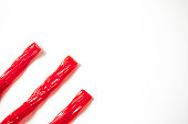 Red candy licorice shot on a white background