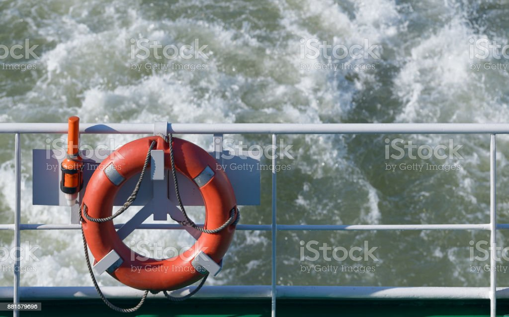 Red life beld at stern of passenger ferry stock photo
