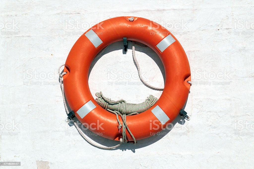 Red Life Buoy hanging on the wall royalty-free stock photo