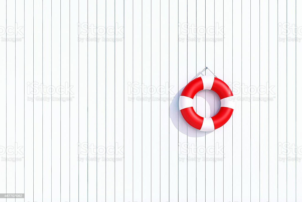 red lifebuoy on a old grunge wooden plank wall stock photo