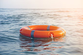 istock Red lifebuoy pool ring float 1177457189