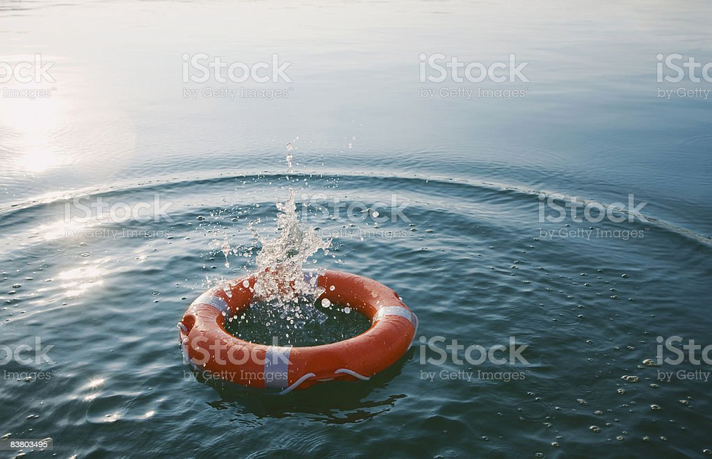 Red life-ring with splash  royalty-free stock photo