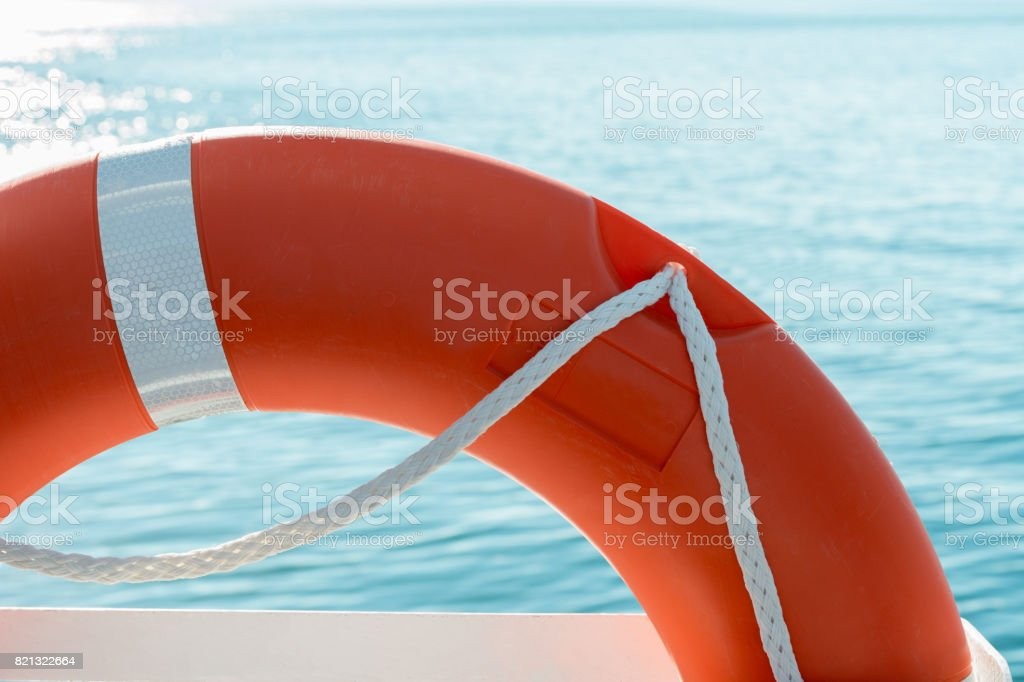 red lifesaver on a boat stock photo