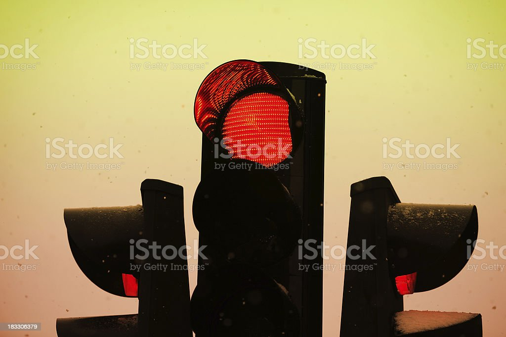 Red light against twilight, Snow in the air royalty-free stock photo