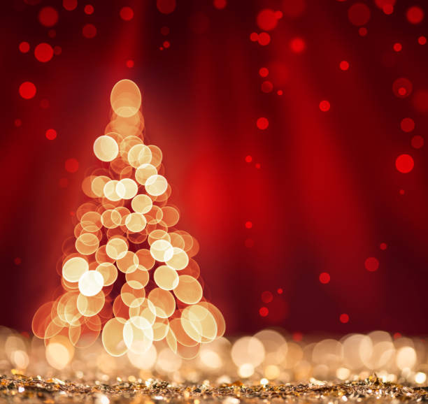 Red light and Christmas Tree on defocused sparkles background stock photo