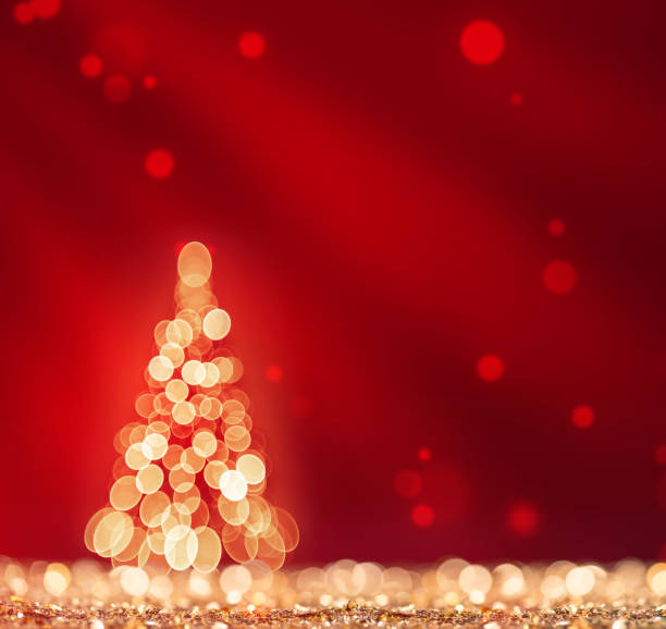 Red light and christmas tree on gold defocused sparkles stock photo