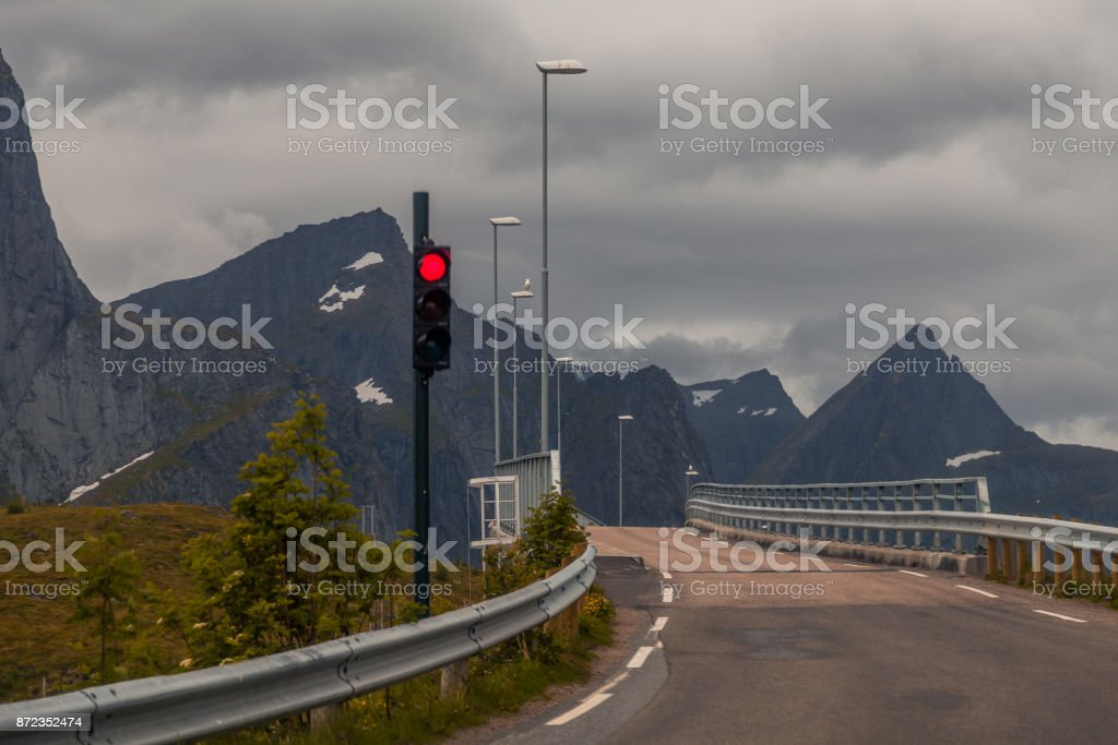 Red light at a narrow bridge stock photo