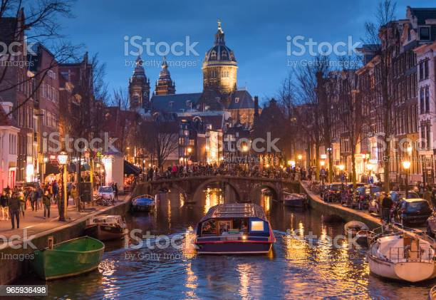 Red Light Destrict View And Amsterdam Canal Bicycles And Cyclists Houseboats Living Boats Stock Photo - Download Image Now