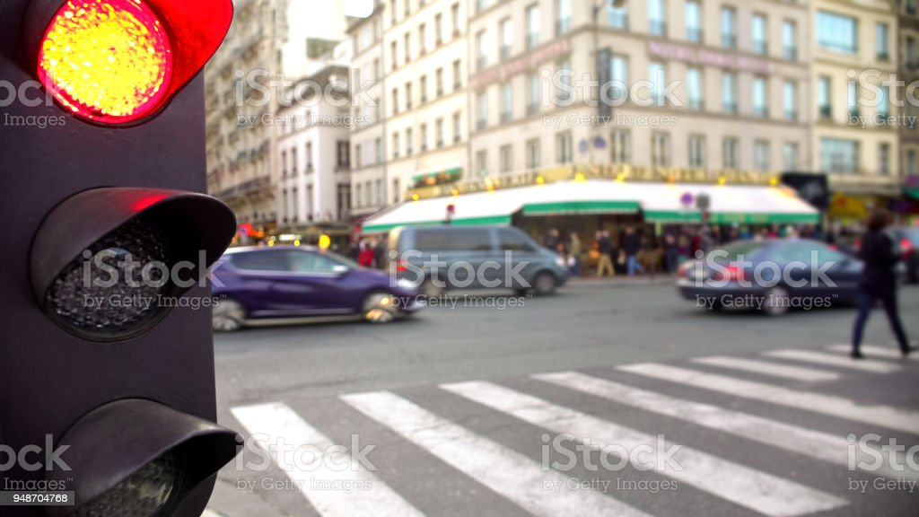 Red light for street traffic, pedestrian crossing road, rush hour in daytime stock photo