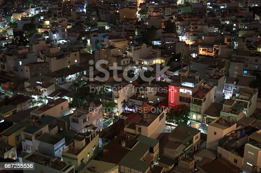 istock Red light of the Cross between the houses of the residential area at night 667255536