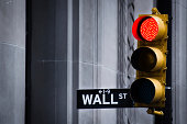 """""""Red stop light at the beginning of Wall Street, New York."""""""