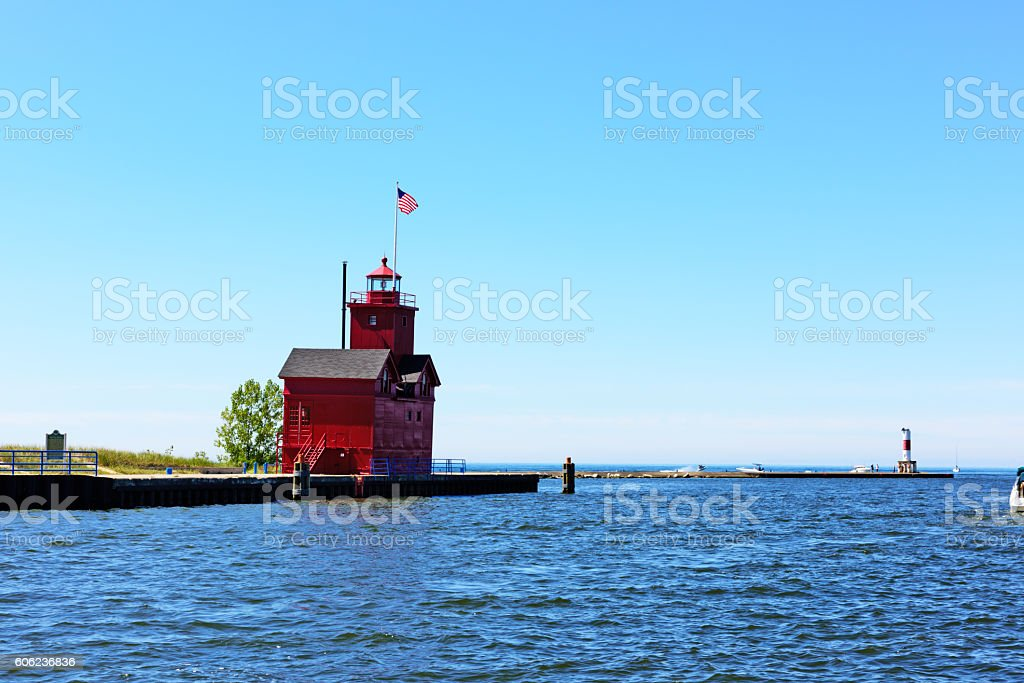 Red lighthouse and harbor entrance, Holland, Michigan stock photo