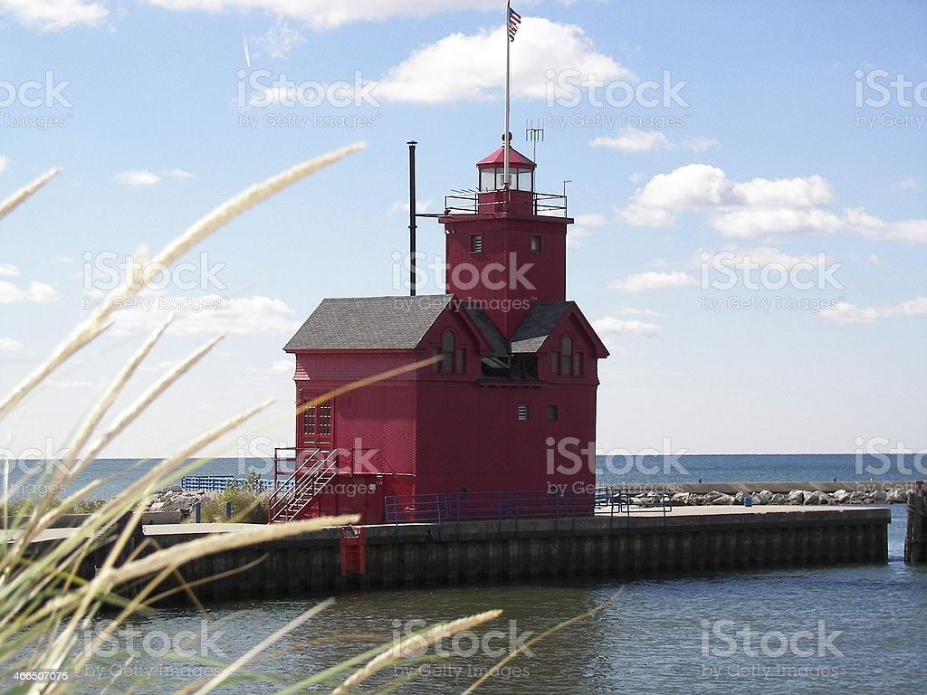 red lighthouse in Michigan stock photo