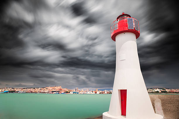 Red lighthouse in the enter of the harbor stock photo