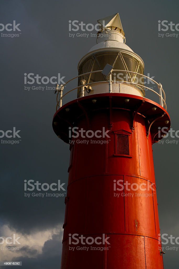 red lighthouse tall stock photo