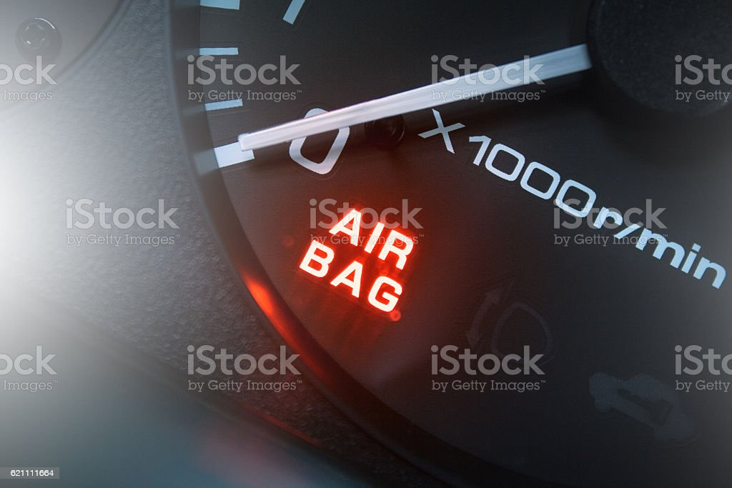 Red lighting air bag control symbol in car stock photo