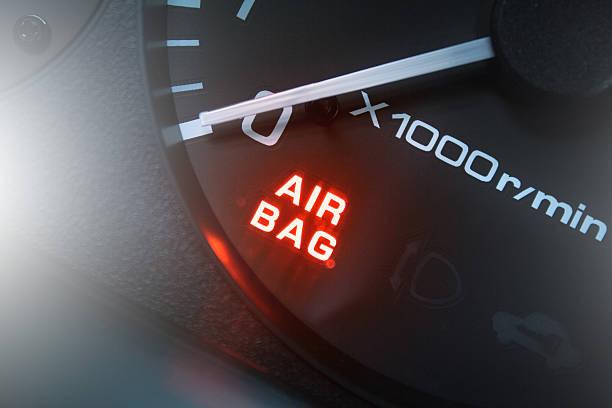 Red lighting air bag control symbol in car – Foto