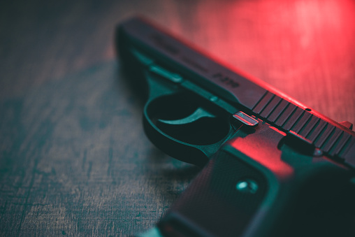 Semi automatic hand gun and red light.