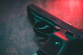 istock Red lighting hand gun 1219883323
