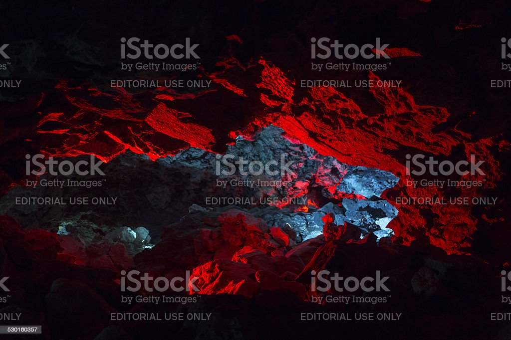 Red lights niche in the cave grotto Meteor stock photo