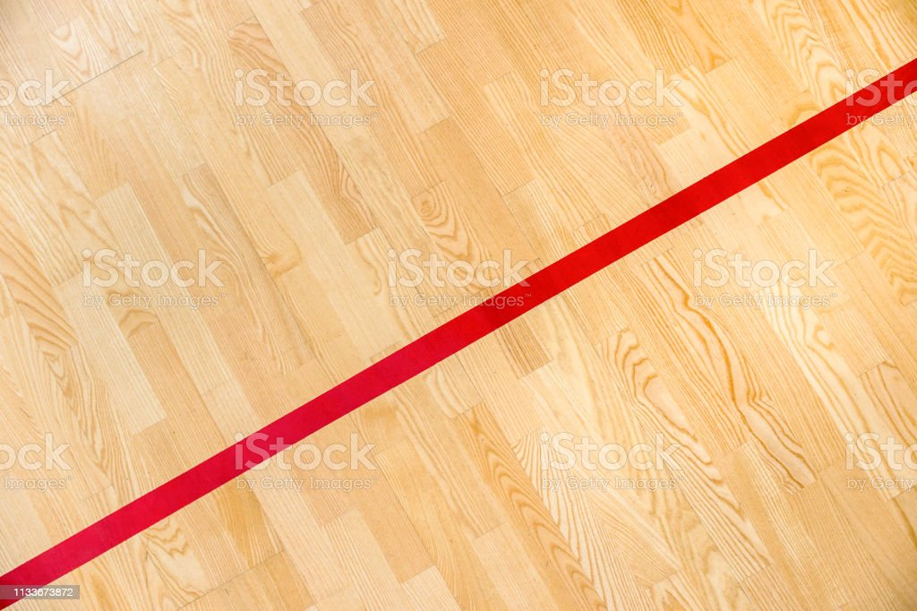 Red line on the gymnasium floor for assign sports court. Badminton,...