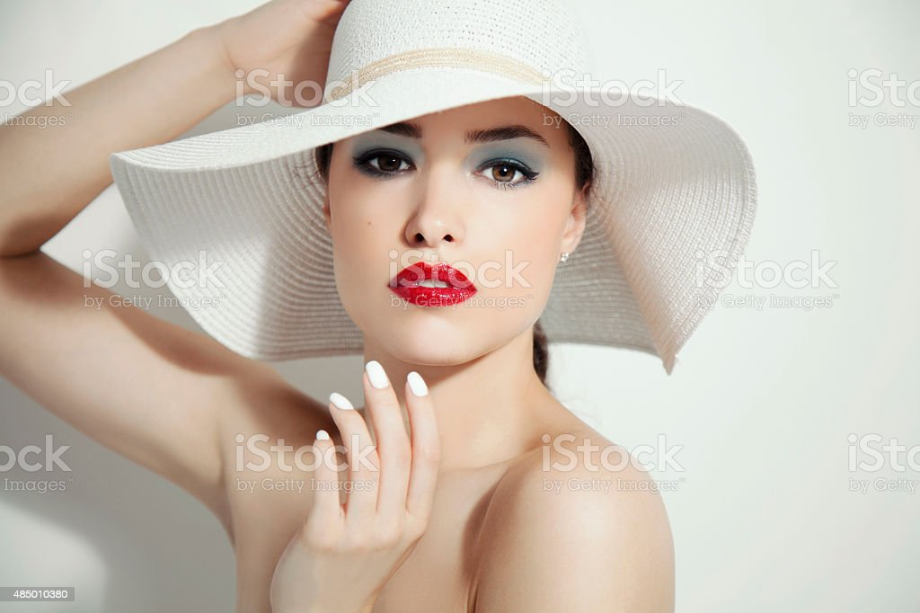 red lips and white hat stock photo