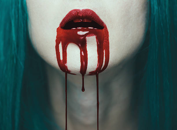 Red lips in blood stock photo