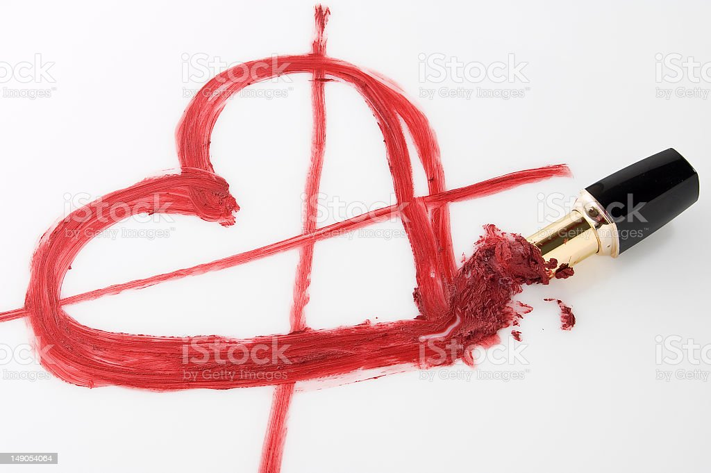 Red Lipstick Drawing a Crossed Out Heart royalty-free stock photo